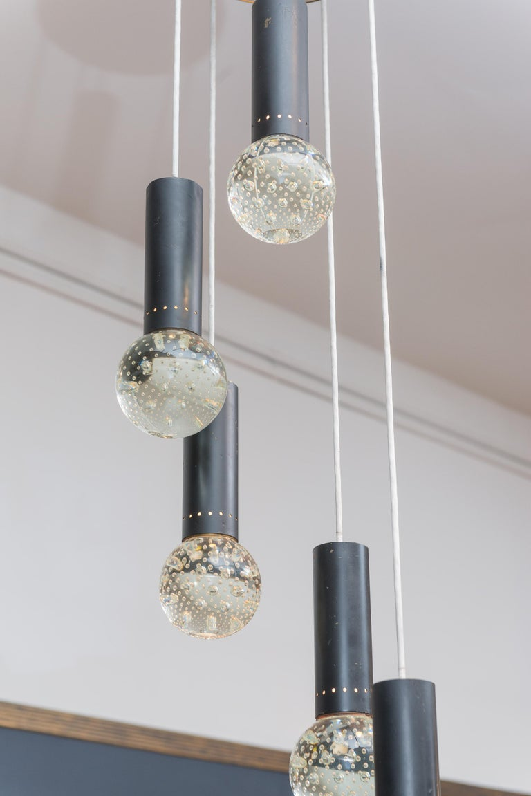Elegant five-light chandelier designed by Gino Sarfatti and Archimede Seguso, Italy. Five solid glass pendant lights with bubble inclusions that cast off small rays of light, stunning.