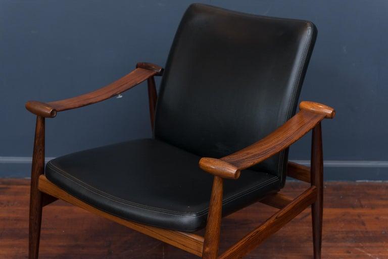 Mid-20th Century Finn Juhl Rosewood Spade Chair Model FD133 For Sale