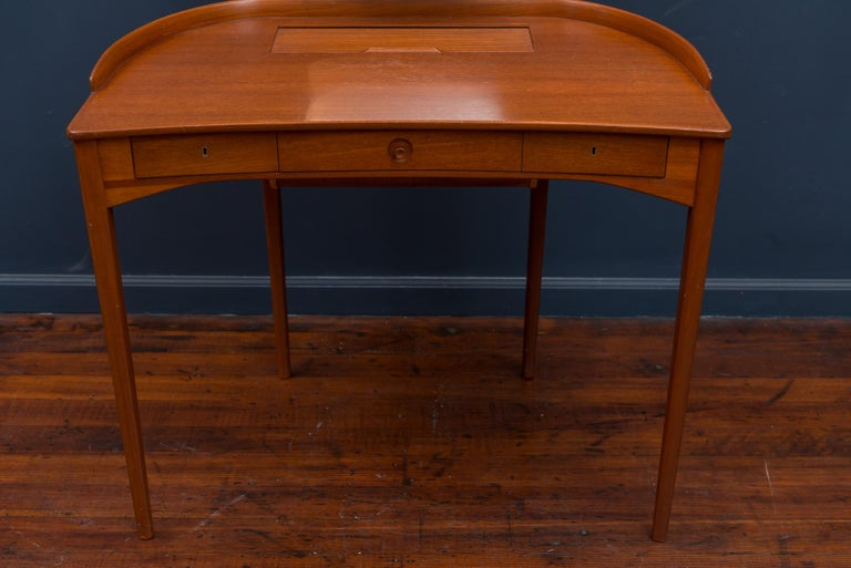 Carl Malmsten teak vanity table with mirror, made in Sweden 1964. Excellent original condition with key.