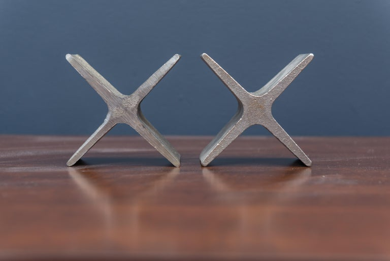Pair of Carl Auböck design bookends in solid cast steel, Austria.