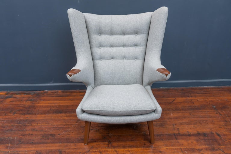 Hans Wegner Papa Bear chair for AP Stolen, Denmark. Perfectly refinished teak arm pads and legs with new light grey wool upholstery.