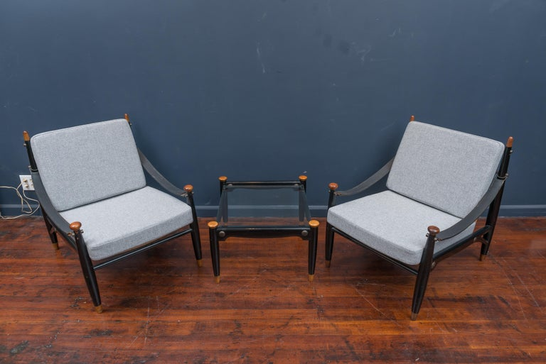 Pair of Mid-Century Modern lounge chairs and matching drinks table. Newly made cushions and upholstered in Danish wool. Chairs are in good condition without any breaks in the cane frames, possibly of Japanese origin.