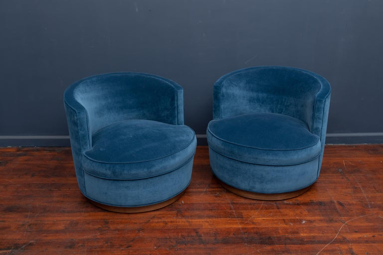 Edward Wormley design for Dunbar swivel club chairs newly upholstered on refinished walnut veneer bases, signed.