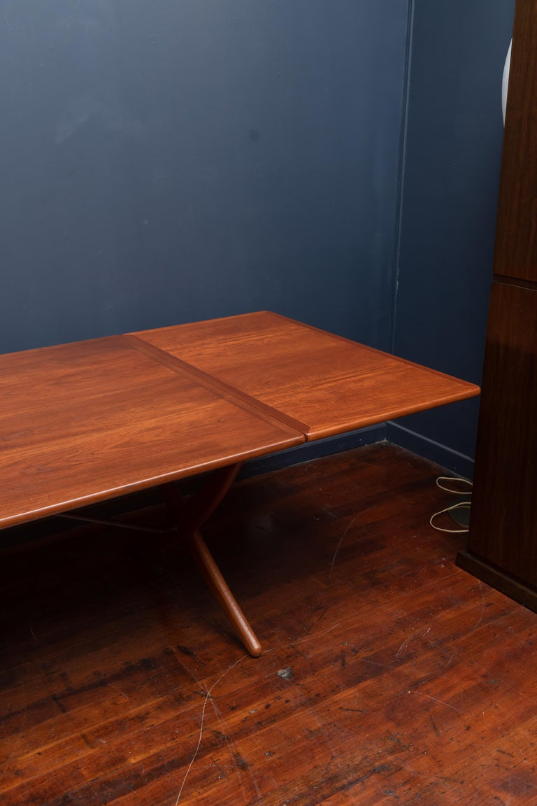 Hans Wegner teak and oak drop leaf dining table, model AT-314 for Andreas Tuck. Perfectly refinished and ready to enjoy, stamped. Dining table width is 122