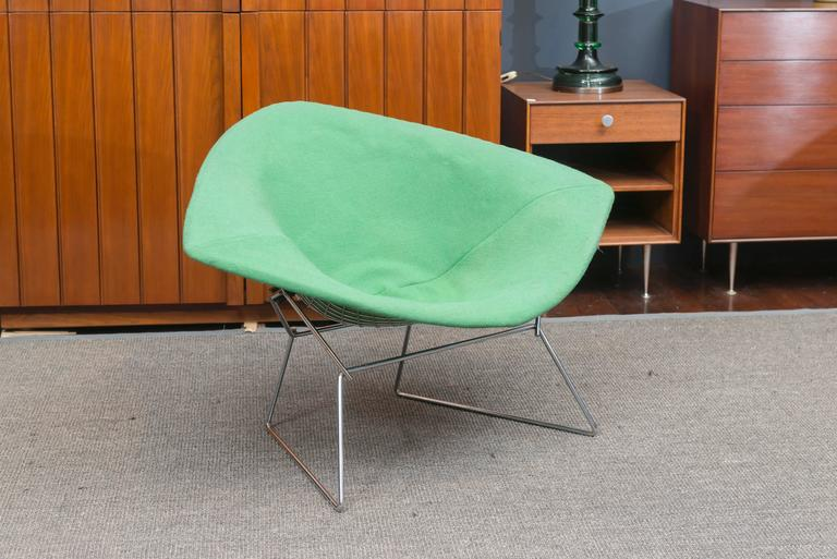 Large chrome diamond chair designed by Harry Bertoia for Knoll, U.S.A. Excellent condition chrome and rubber shocks, original hop sack pad has some light spotting.