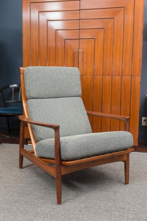 Folke Ohlsson design teak high back lounge chair, newly refinished and upholstered.