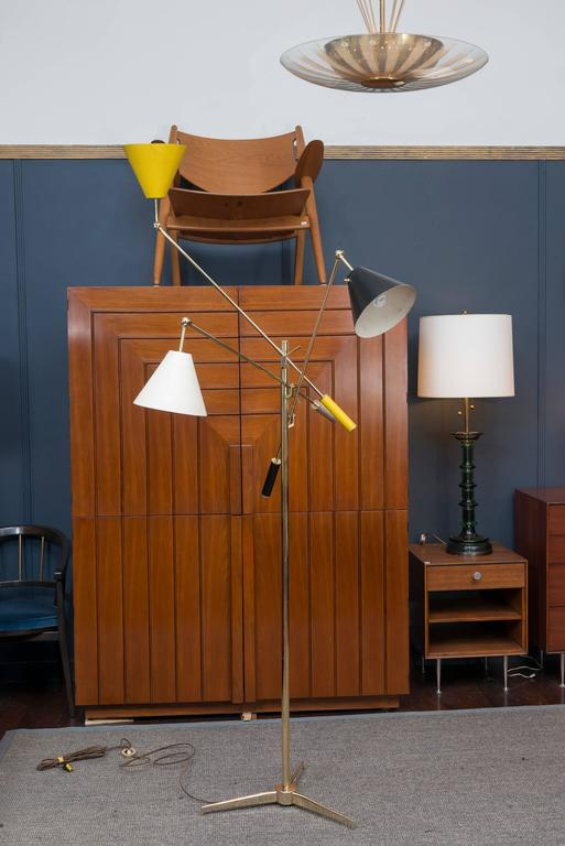 """Arredoluce """"Triennale"""" three-arm brass floor lamp, Italy, 1950s. Three enameled steel shades, yellow, black and white and matching handles in excellent original condition. Totally re-wired using the original floor switch and the brass frame"""