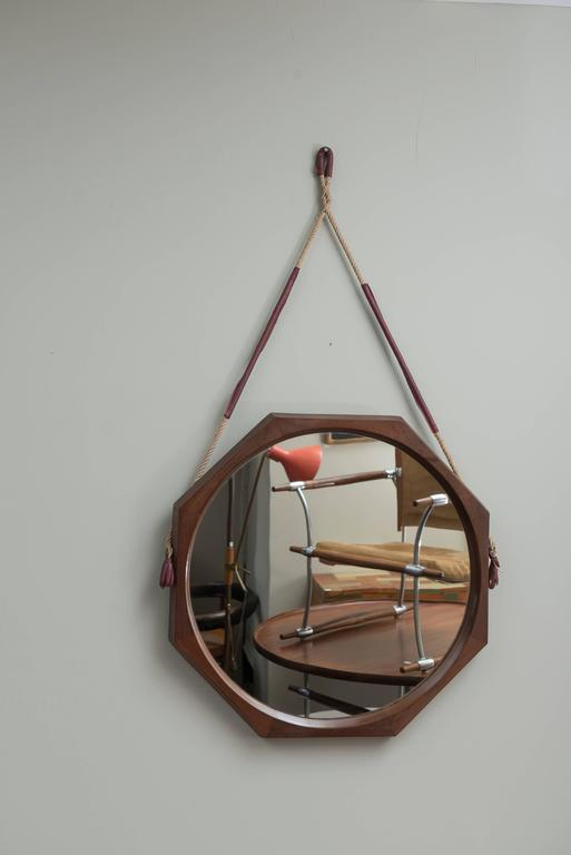 Unusual and large octagonal form wall mirror made from rosewood with leather wrapped rope supports. 