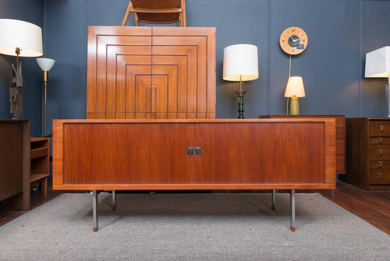 "Hans J Wegner design ""President""teak tambour door credenza for Ry mobler with fitted oak interiors on an elevated stainless steel frame. Perfectly refinished and ready to enjoy."