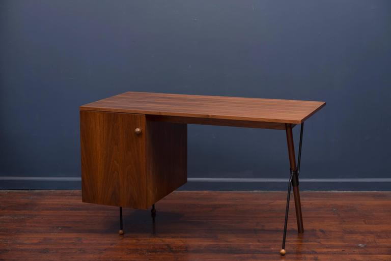 Greta Grossman designed desk for Glenn Furniture Company. Walnut case has been professionally refinished and the metal supports and legs remain in very good original condition. Desk is missing the interior pencil and file drawers.