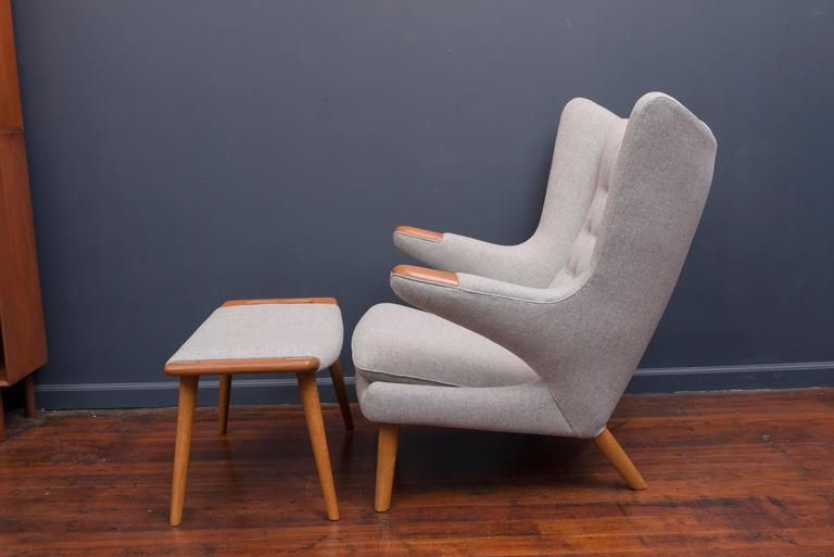 Perfectly restored Hans Wegner papa bear chair and ottoman newly refinished and upholstered in a light grey Danish wool. Simply the most comfortable chair you will ever own.