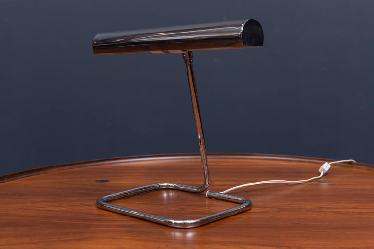 Elegant articulating chrome desk lamp made by Koch & Lowy in excellent original condition.