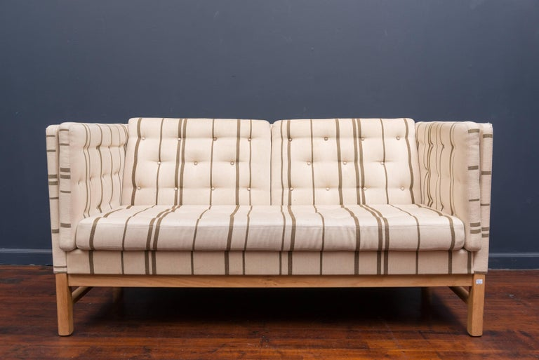 High quality love set or small sofa designed byErik Ole Jørgensen for Svendborg, Denmark. Oak frame with original vintage upholstery that has been professionally cleaned but shows wear and tear with some staining.