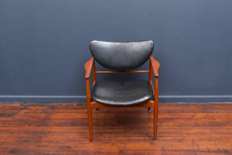 Finn Juhl model NV 48 armchair for Niels Vodder, with embossed stamp to rear stretcher. Excellent re-stored condition.