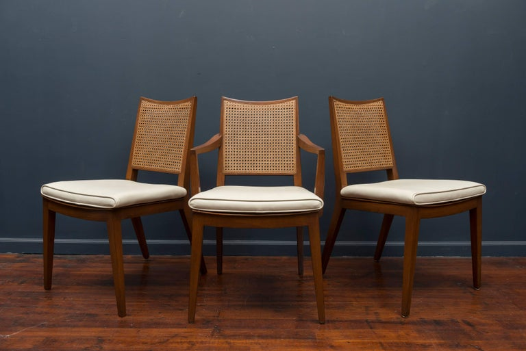 Edward Wormley design for Dunbar set of six mahogany and cane dining chairs, comprising five side and one armchair. Perfectly refinished and newly caned with original seat pads, labeled.
