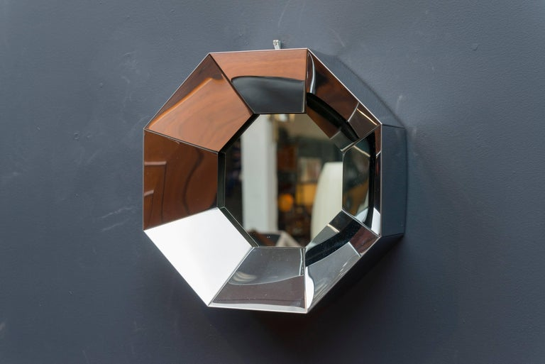 Striking octagonal design chrome wall mirror by C.Jere, signed and dated 1976.