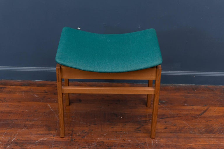 Architectural design Danish teak foot stool made by France & Davoriksen, Denmark. Excellent original condition finish and fabric ready to enjoy!