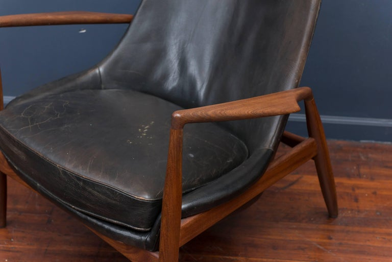'Seal' lounge chair model 503-799, in teak and original black leather, by Ib Kofod-Larsen for OPE, Sweden, 1956. Beautiful and iconic seal lounge chair shows the designer's command of structure and comfort. This chair is direct from the original