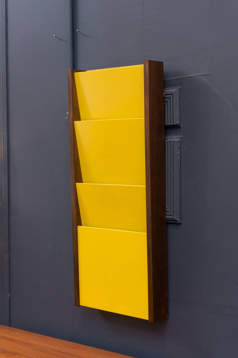 Fun yellow magazine rack mad by Peter Pepper Products.