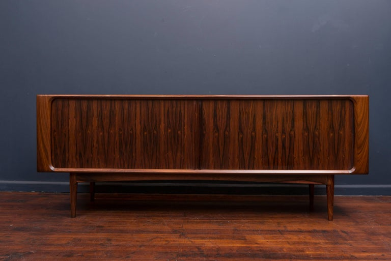 Exceptional quality design tambour door credenza with highly figured rosewood grains throughout and a fitted interior.
