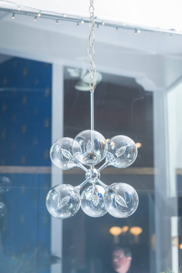 Timeless chrome six-light Sputnik chandelier in excellent original condition with 12ft. of chrome chain.