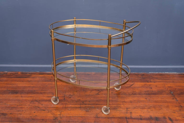 Hollywood Regency patinated brass and glass bar cart.