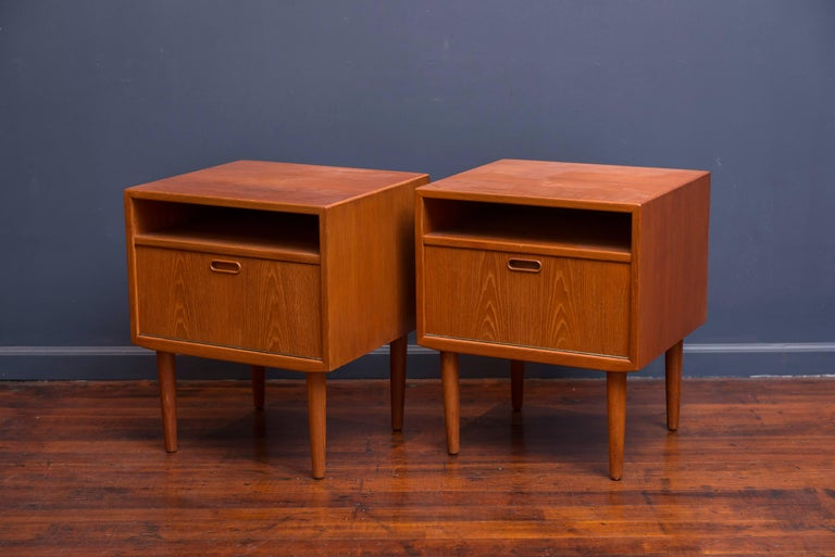 Nice pair of newly refinished teak Danish modern nightstands. Unusual drop down drawer front, ready to enjoy.