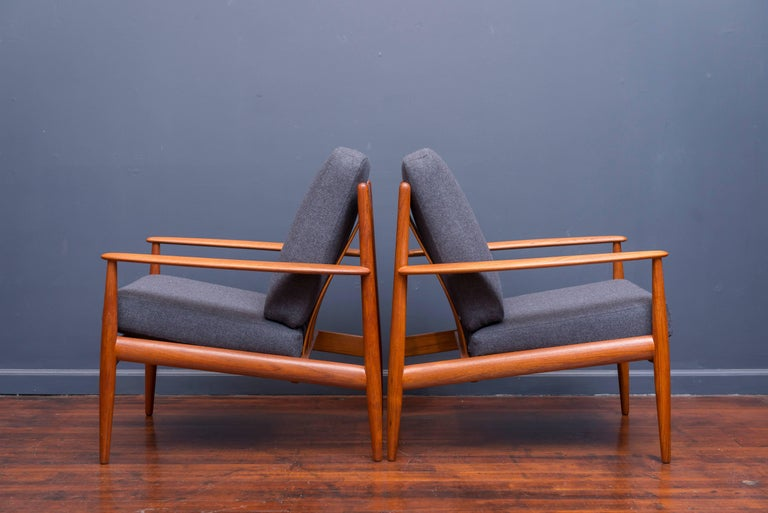 Pair of Greta Jalk design teak lounge chairs for France & Davoriksen, Denmark. Perfectly refinished with new cushions in Danish wool, labeled.