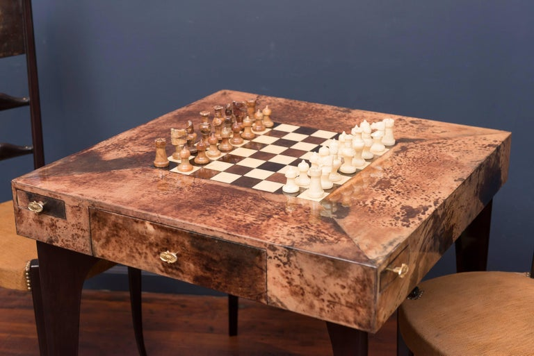 Aldo Tura games table and matching chairs, excellent restored condition with original chess set.