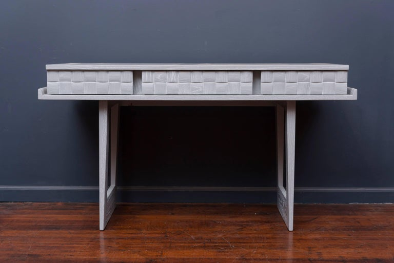 Paul Laszlo design writing desk or console table for Brown Saltman Furniture Los Angeles, CA. Pickled oak finish in a light grey lacquer. Excellent restored condition.