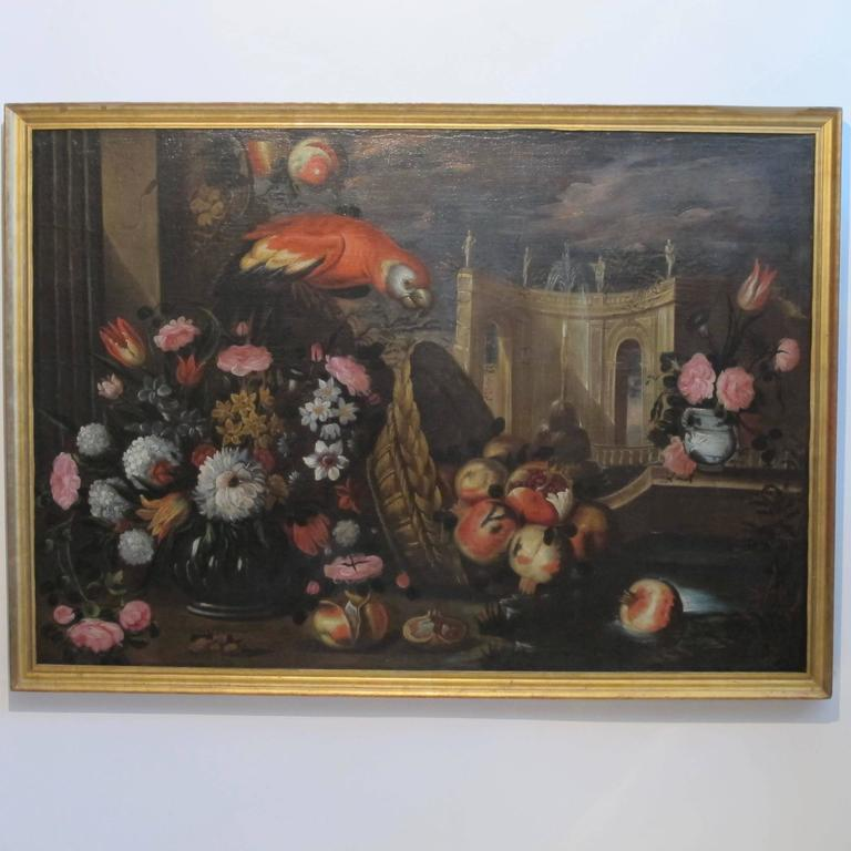 A very large and impressive Baroque era still life painting with parrot and flowers. Oil on canvas in giltwood frame. Italy, late 17th century-early 18th century.