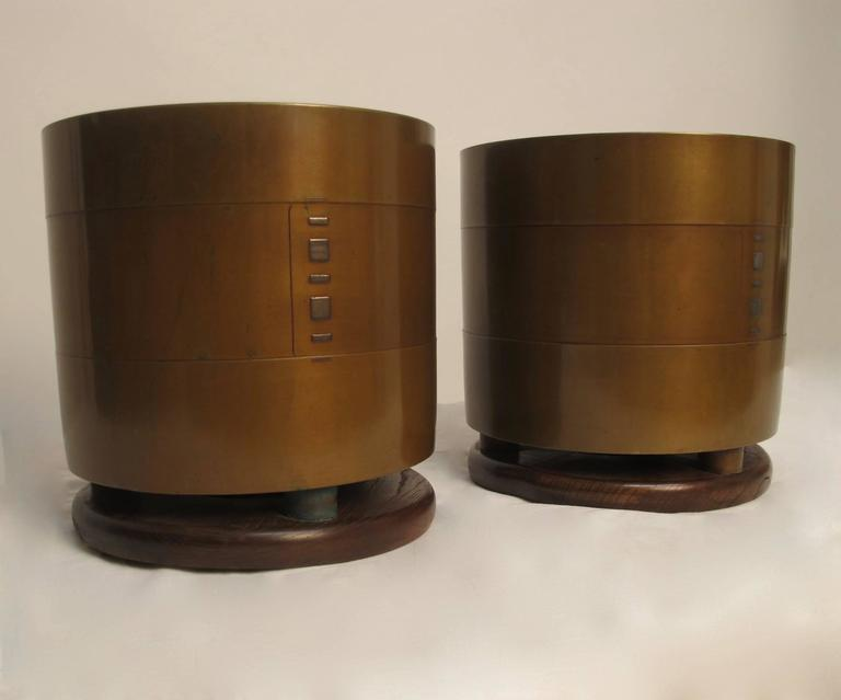A superb pair of bronze planters with original box and cloth liners. Having silver inlay detail on the bronze, the urns are affixed to Kiri Wood bases. Reputedly from the collection of John Traina. Black lacquer stand included. Japan, early Showa