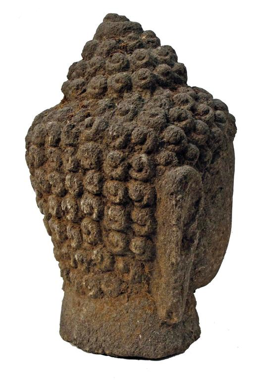 Large carved volcanic stone buddha head sculpture at stdibs