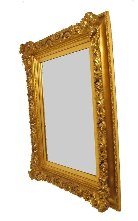 A very fine quality mercury gilded portrait frame now converted to a mirror. Beautiful antique condition. American, late 19th century.