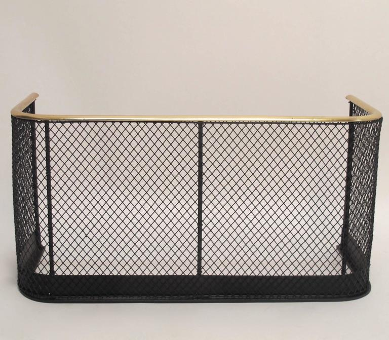 Unusual hard to find small size brass and iron fire fender with wire screen. English, early to mid-19th century.