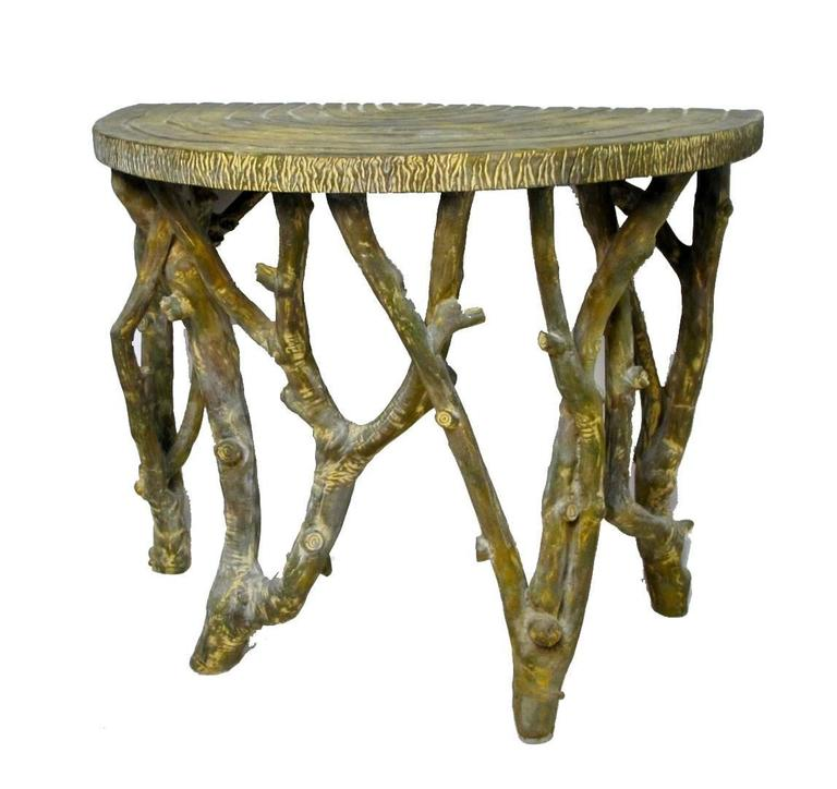 Originally purchased from Gumps in the 1970s. High end designer faux tree branch demilune style table, cast from composition material. America, mid-20th century.