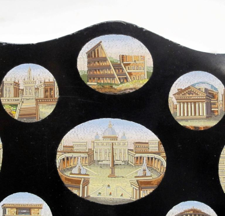 Grand tour plaque having nine oval very fine tesserae micro mosaic panels of Roman views set into a slate tablet, Italy, 19th century.