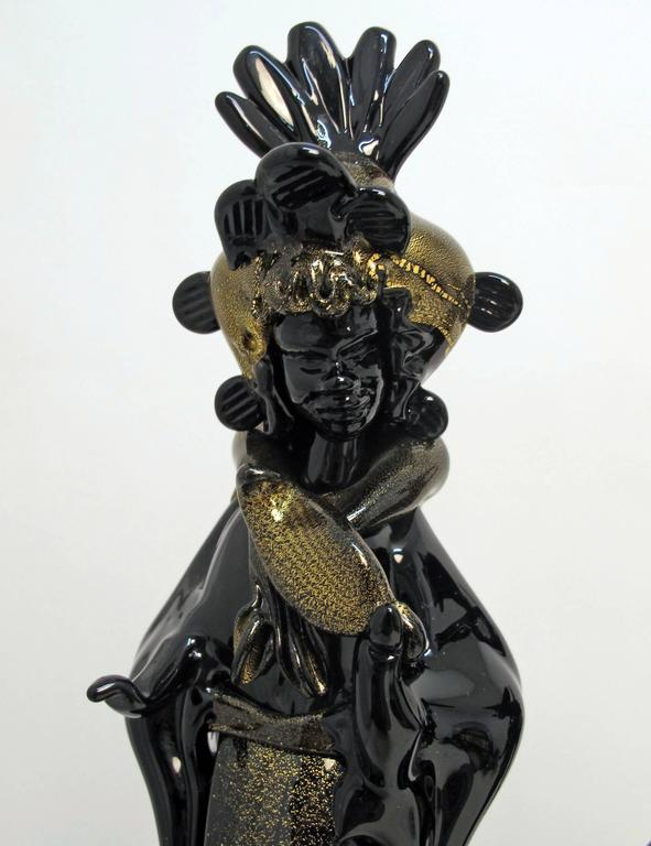A fine pair of Moorish Figures in Venetian Dress.  Hand blown Black Murano Glass with Gold accenting by Barovier, Italy, 1930s.