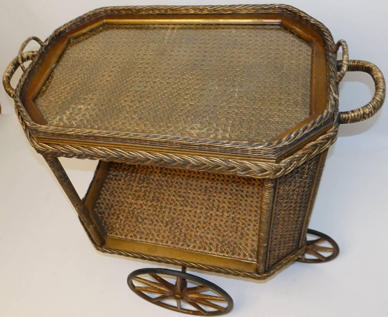 Original Heywood Bros. Wakefield Co. wicker and cane bar cart drinks cart with removable tray. The gold finish is original to the piece, all wheels are in working order the front and rear wheels allow the cart to turn in a 360 degrees.