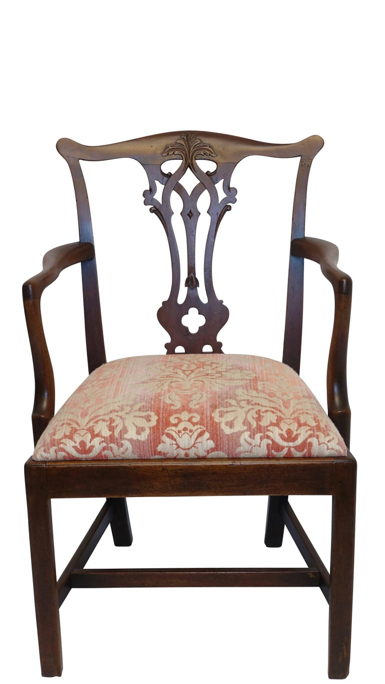 Georgian mahogany ribbon carved back splat armchair with leaf carved shaped crest rail with upholstered drop in seat, English, circa 1820.