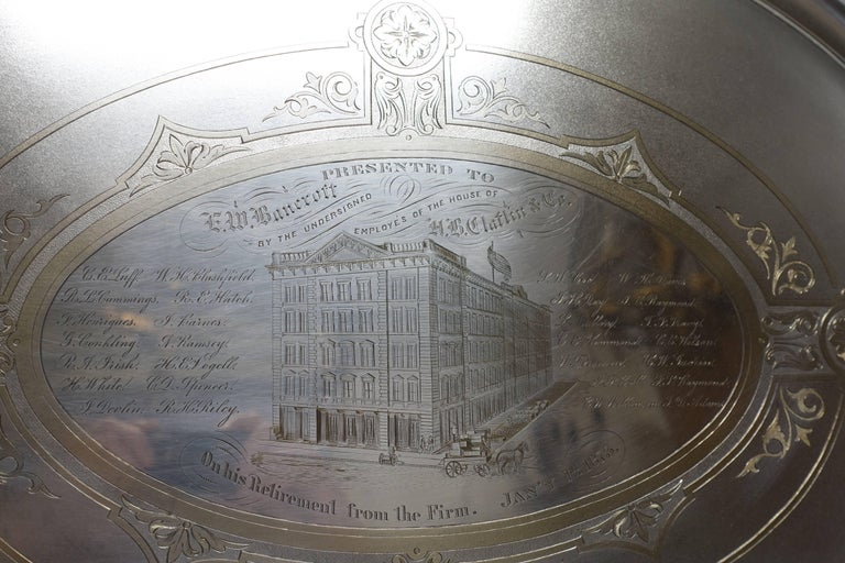 Impressively large Aesthetic Movement handled silver plate tray with very fine engraving. Beautifully hand written script, fine detailing to the building and horse pulling a cart full of boxes, having a pale gold wash over the engraving. Presented