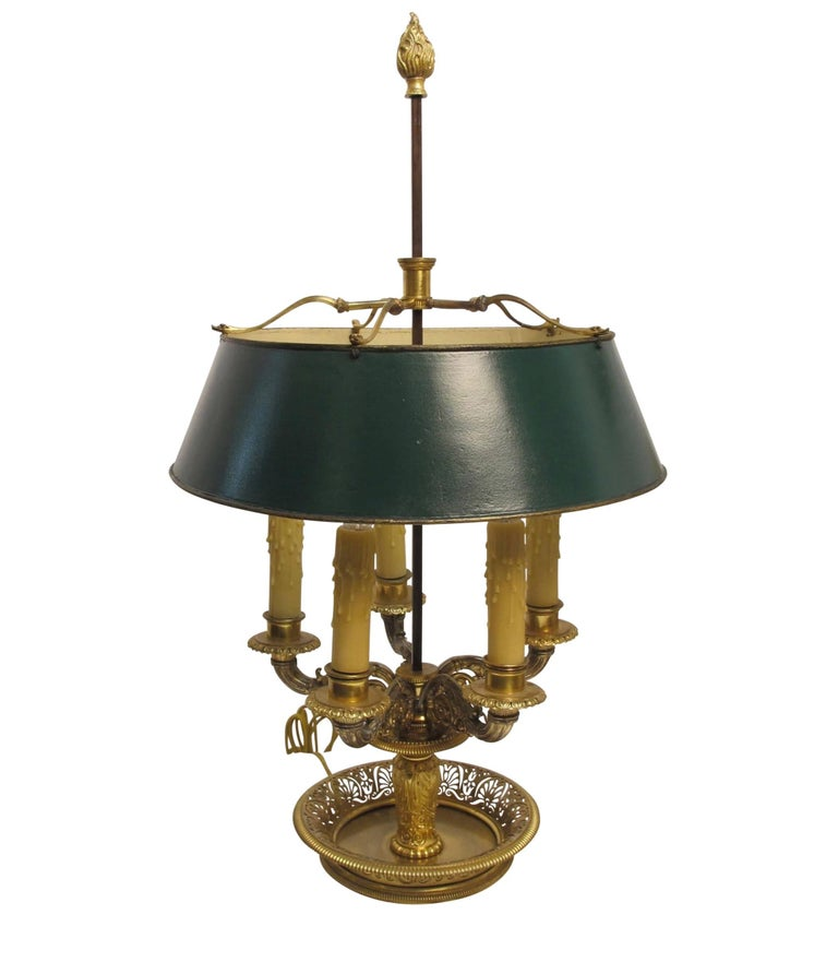 An extraordinary bronze bouillotte table lamp with original gilding and exquisite detail, having a green painted tin shade. Fine quality casting and hand cut open work in the tray. Newly re-wired and reconditioned, France, early 19th century.