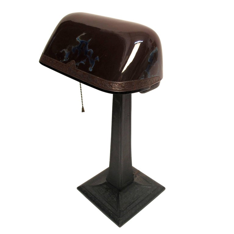 Emeralite desk lamp with unusual cased art glass shade and metal base, American, early 20th century.