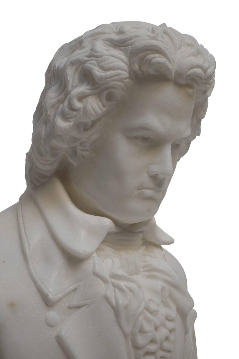 A fine example of a hand-carved Carrera marble bust of Beethoven. Having an interesting matrix on his back shoulder. This bust is half life size, 19th century.