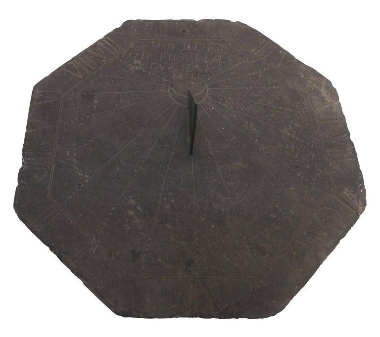 A 16th century slate stone sundial with bronze gnomon (the gnomon is not original).