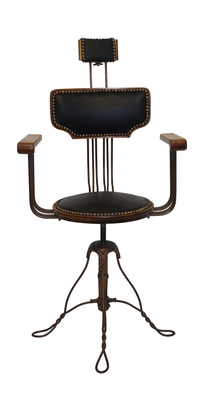 Unique and unusual bent steel with copper finish barber's chair with adjustable seat height, and adjustable backrest and headrest. Completely refurbished with new black leather upholstery and brass tacking. American, circa 1920.