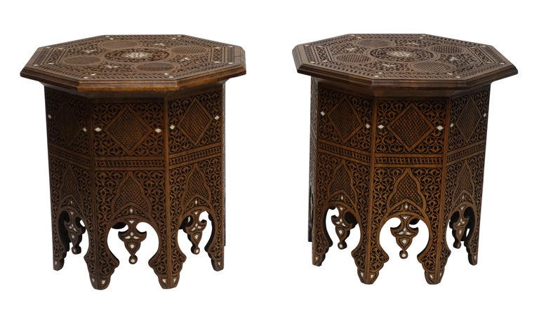 A pair of midcentury Moorish style highly carved tabouret tables with bone inlay detail. Last half of 20th century.