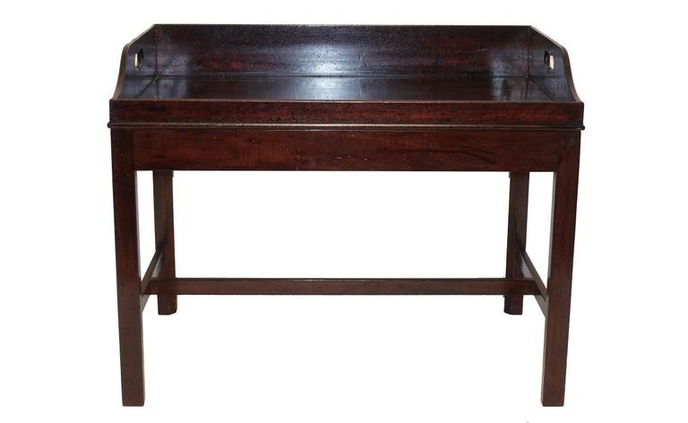 Georgian mahogany butlers tray on later made mahogany stand, England, mid-19th century.