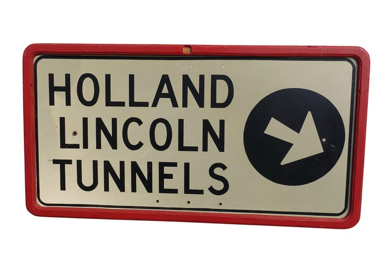 Original enamel highway sign for the Holland Lincoln Tunnels, framed in a later red painted wood frame, American, mid-20th century.