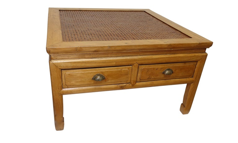 A low table with an inset woven panel top surface and having two drawers, China, late 19th-early 20th century.